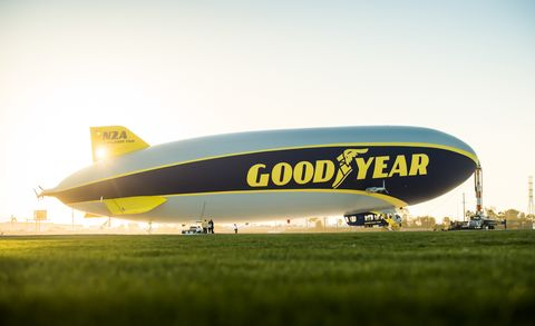 Blimp, Vehicle, Air travel, Zeppelin, Airship, Aircraft, Yellow, Aviation, Aerostat, Flight,
