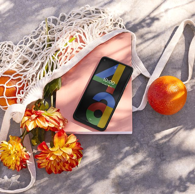 google pixel 4a in market bag with flowers and orange
