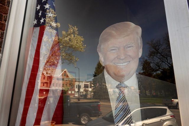 """elkhorn, wisconsin   may 15 a cutout of president donald trump sits in the window of the headquarters for the walworth county republicans on may 15, 2020 in elkhorn, wisconsin  in a 4 3 decision, the wisconsin supreme court overturned the state's stay at home order, deeming it """"unlawful"""" and """"unenforceable"""", allowing non essential businesses to reopen this week   photo by scott olsongetty images"""