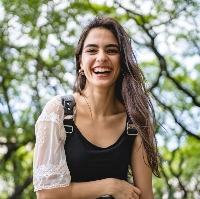 gorgeous natural beauty woman smiling at the camera
