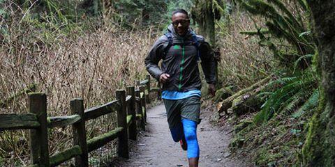 Gregory Gourdet runs through woods