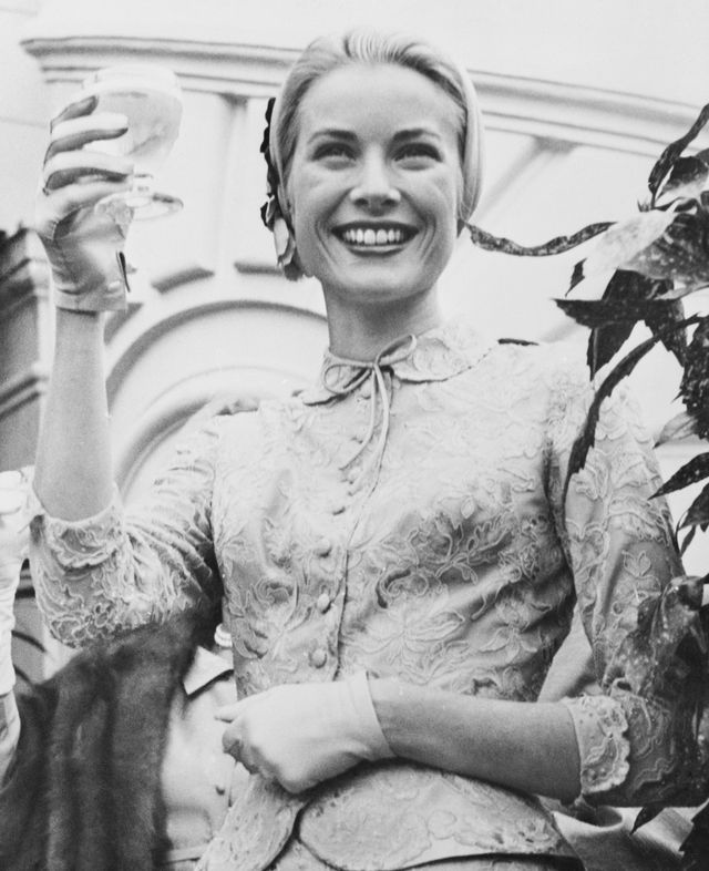 original caption princess grace toasts wedding guests monte carlo, monaco just brimming over with happiness, princess grace holds up her glass to toast the guests at the garden party that followed her civil wedding to prince rainier on wednesday the party was held on palace grounds yesterday, grace and the prince were wed in a brilliant roman catholic ceremony in monaco cathedral april 20, 1956