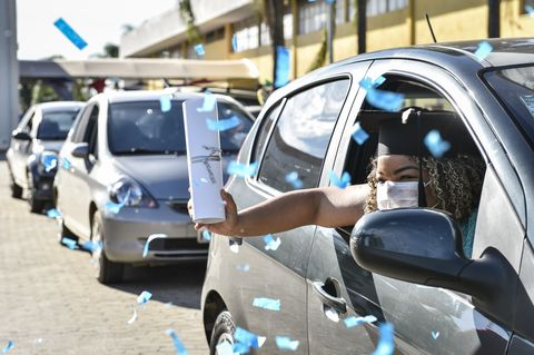 medical and nursing school graduates from faseh university receive their diplomas via drive thru amidst the coronavirus covid   19 pandemic