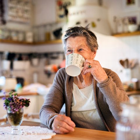grandmother at home drinking tea