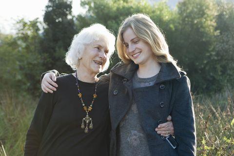 Grandmother hugging granddaughter