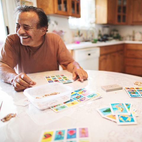 Grandpa and granddaughter play lotería