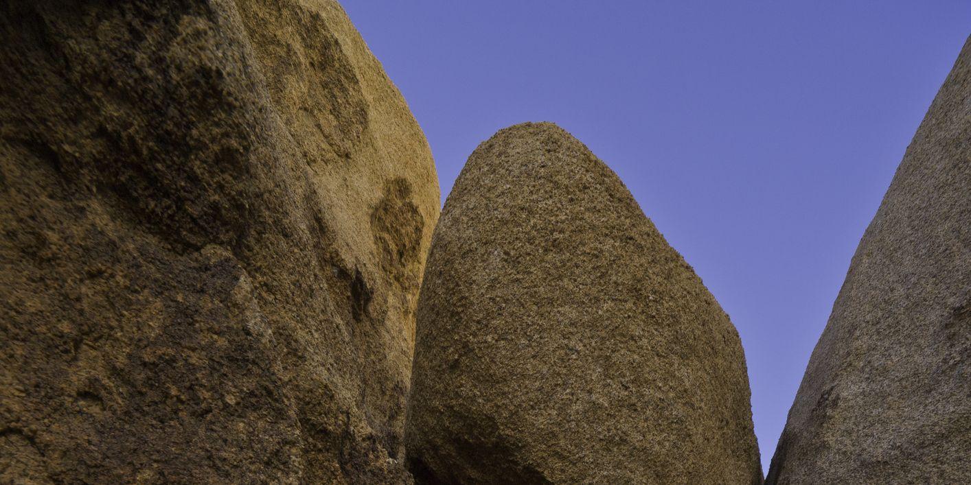 Granite boulder jammed between rocks, California