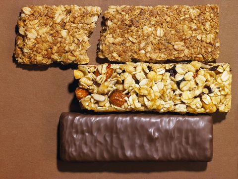 Granola, and chocolate energy bars, top view.