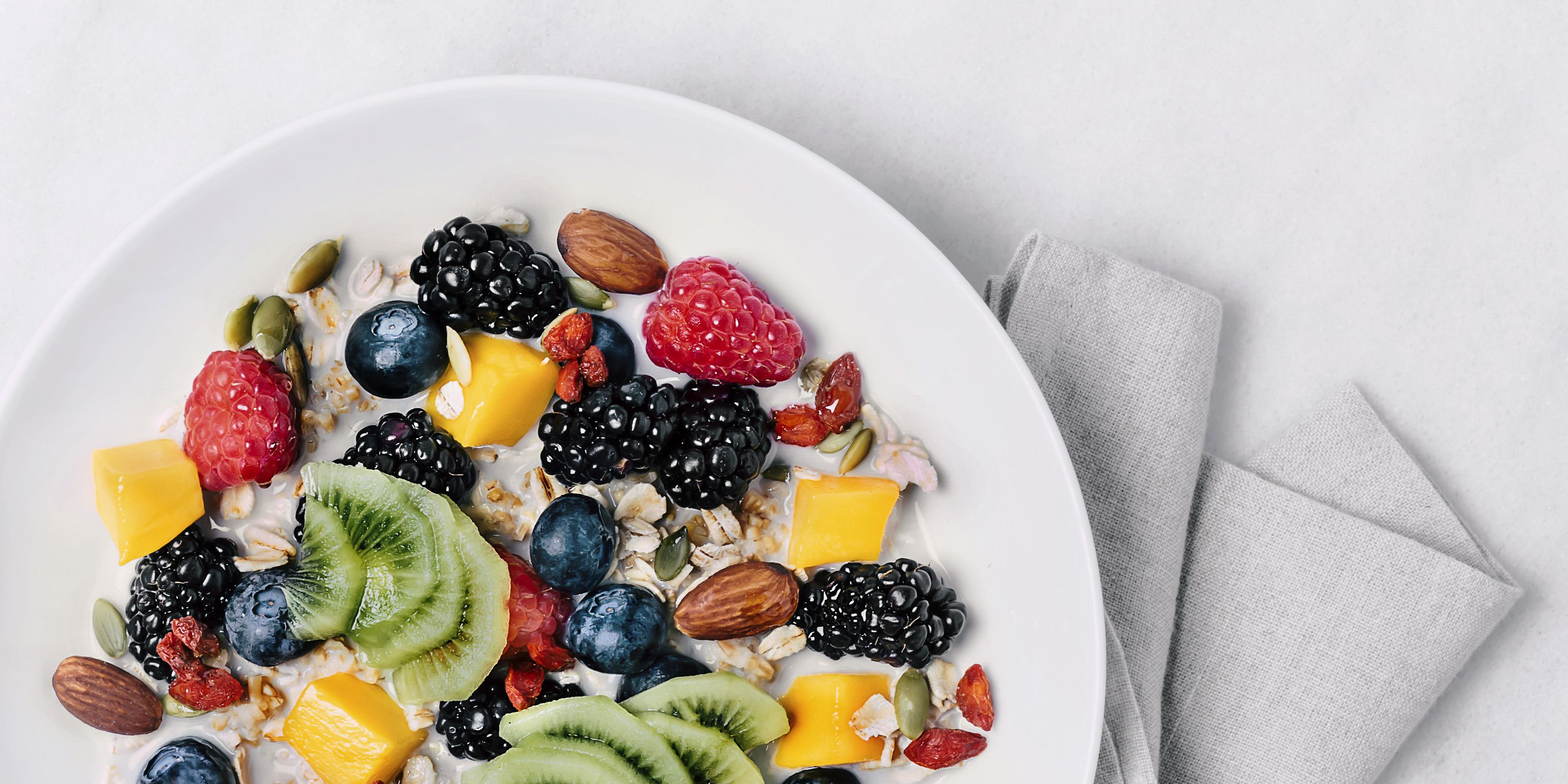 Granola with milk and a variety of fresh and dried fruits
