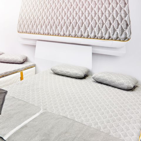 Gray mattress on double bed in store