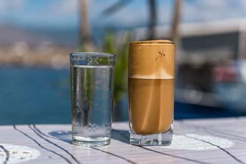 Greek Frappe iced coffee drink served with water, Lesvos, Greece