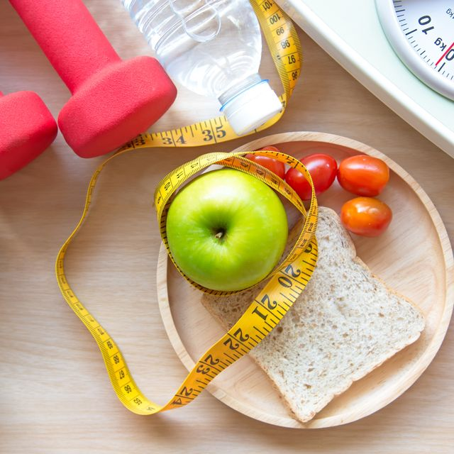 green apple and weight scale,measure tap with clean water and sport equipment for women diet slimming  diet and healthy concept