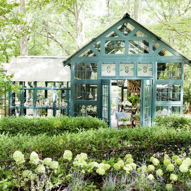 green garden retreat made of salvaged windows