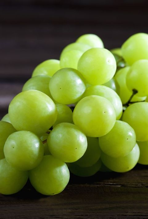 Green grape on wood