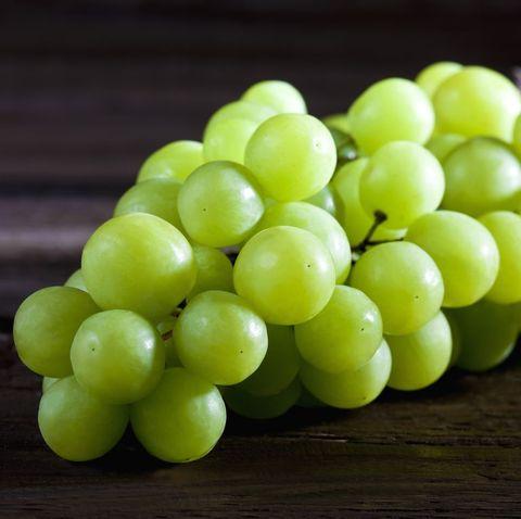 Green grape on wood
