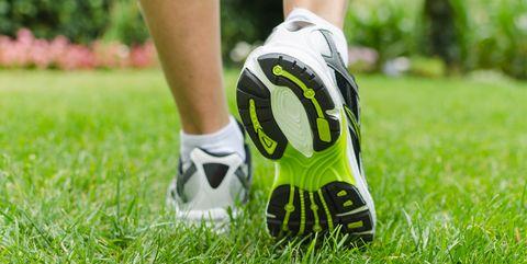 Green heels of a woman's sneaker as she ran on grass
