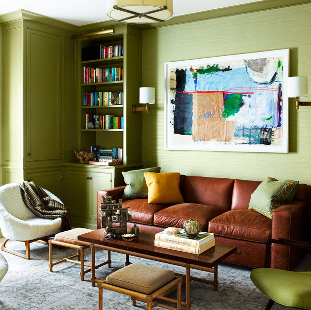 green living room with leather sofa