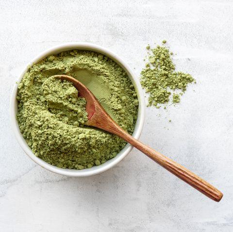 Green matcha tea powder. Top view.