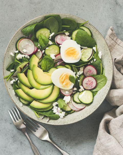Green salad with radish, avocado, spinach