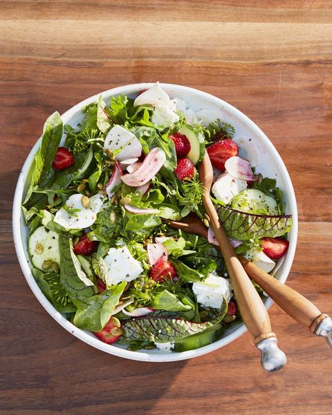 green salad with turnips, strawberries, and pepitas