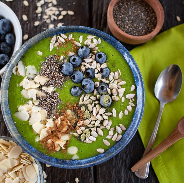 green smoothie bowl with almonds, blueberries, chia and sunflower seeds