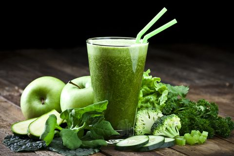 green vegetable juice on a rustic wood table