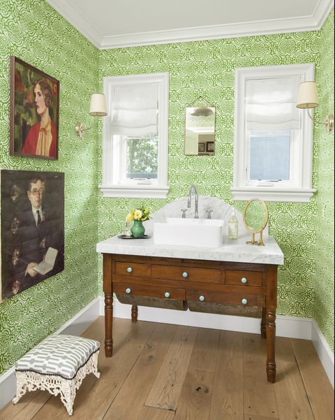 powder room with green wallpaper