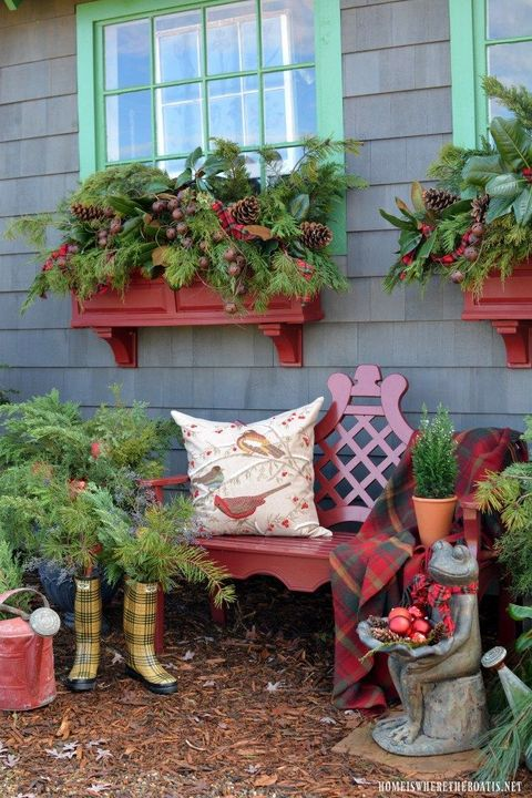 greenery and pine cone window boxes