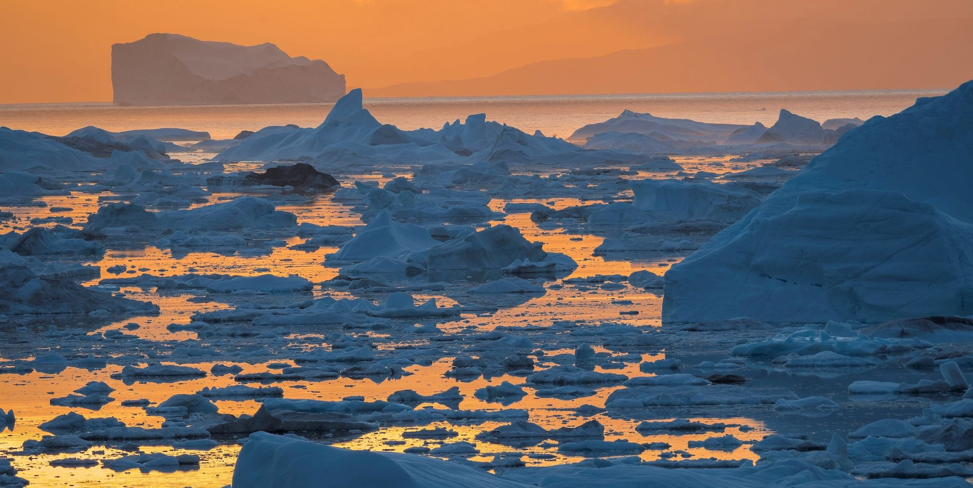 Ilulissat Icefjord also called kangia or Ilulissat Kangerlua sunset over Disko Bay The icefjord is listed as UNESCO world heritage America North America Greenland Denmark