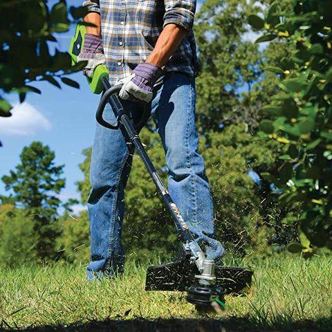 Lawn, Grass, Gardener, Tree, Outdoor power equipment, Plant, Soil, Jeans, Edger, Weeder,