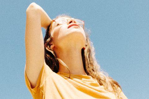 Shoulder, Yellow, Beauty, Arm, Joint, Neck, Summer, Human body, Sunlight, Long hair,