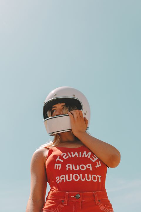 White, Red, Shoulder, Personal protective equipment, Helmet, Joint, Headgear, Photography, Neck, Elbow,