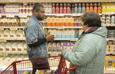 marsha marley of portland, right, talks with trader joe's crew member terry hand during the portlan