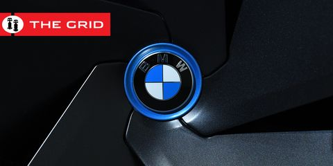 Logo, Vehicle, Emblem, Font, Car, Vehicle door, Steering wheel, Gadget, Graphics, Bmw,