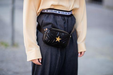 Street fashion, Clothing, Waist, Leather, Shoulder, Joint, Belt, Yellow, Fashion, Arm,