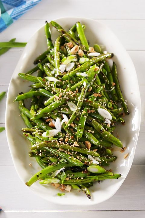 grilled green beans in white serving dish