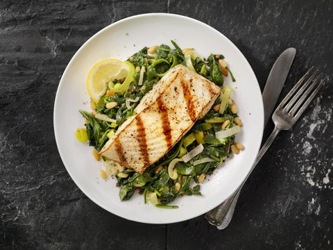 grilled halibut with spinach, leeks and pine nuts