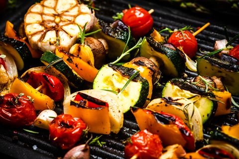 bbq grilled wegetables on skewers with fresh herbs and spices summer barbecue food