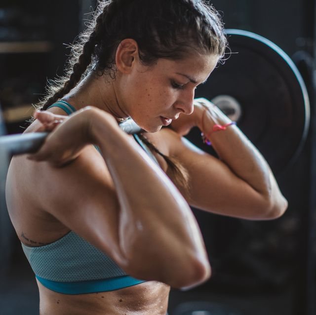 gritty women lifting barbell