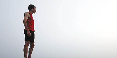 Eric Grossman standing on top of a ridge