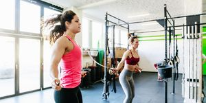 Group Of Gym Goers Using Skipping Ropes