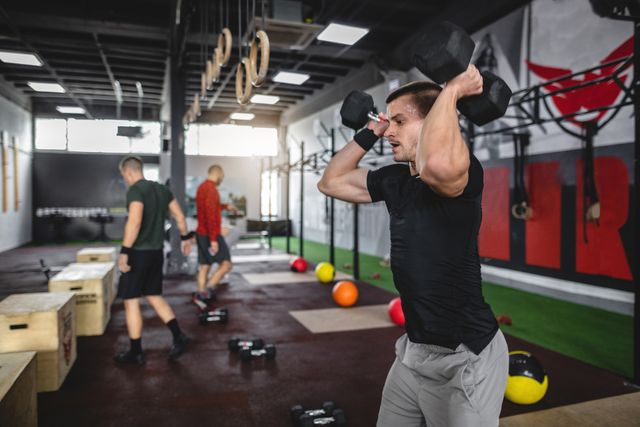 group of men exercising at a gym on a cross training
