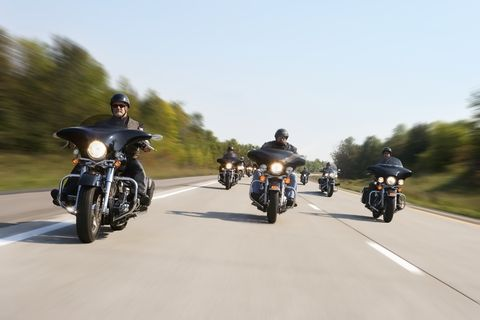 Group of motorcyclists riding, (blurred motion)
