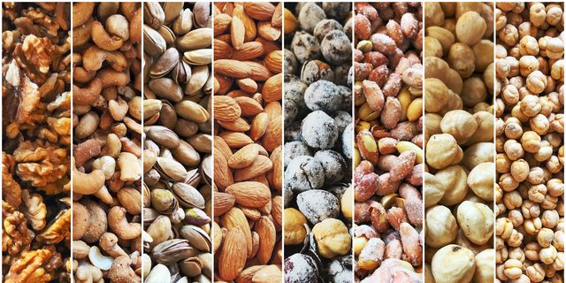 group of nuts as background walnuts, cashew, pistachio, almonds, hazelnuts, peanuts and chickpeas