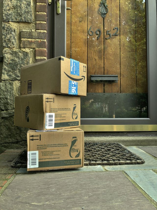 group of packages delivery to doorsteps on staircase of house