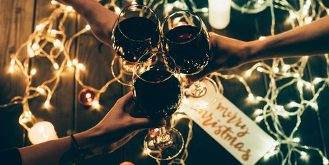 Group of people clinking wineglasses