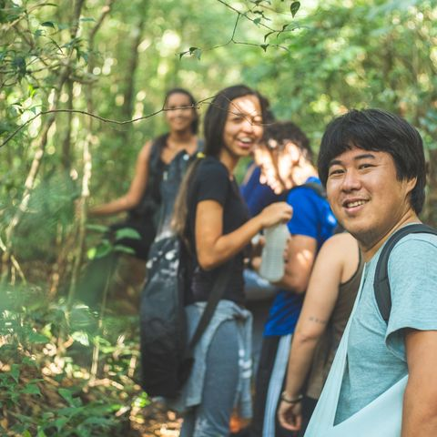 group of people exploring the forest