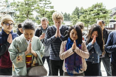 Group of tourists in japanese temple