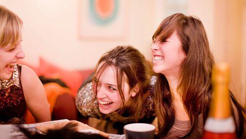 uk   london   young adults enjoying an evening at home