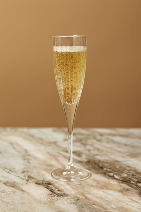 Champagne cocktail, Drink, Champagne stemware, Glass, Alcoholic beverage, Water, French 75, Classic cocktail, Stemware, Cocktail,